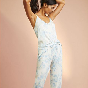 woman wearing white and blue floral sleep cami and pant from anthropologieop. photo