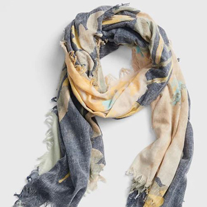 navy, yellow, and green floral scarf with fringed ends photo
