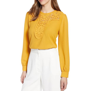 woman wearing gold long sleeve blouse with lace details photo
