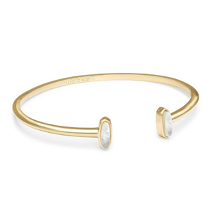 Gold pinch cuff bracelet with oval mother of pearl stones on each end photo