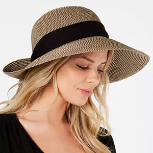 woman wearing a woven floppy sun hat with black band photo