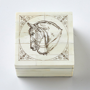 Wooden box with horse head etched on top photo