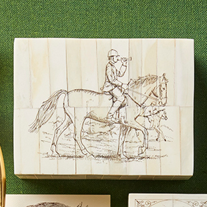 Wooden box with horse and rider etched on top photo