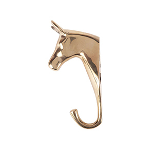 Brass horse head with a brass hook attached photo