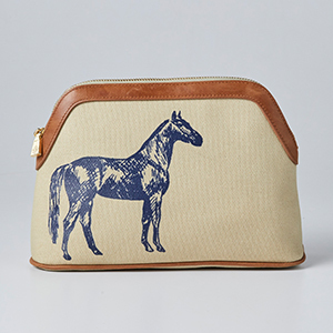 Tan cosmetic bag with a blue horse stamped to the side photo
