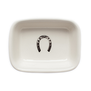 White soap dish with a black horseshoe in the center photo