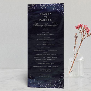 Indigo wedding program with gold foil twinkled on the top and bottom photo