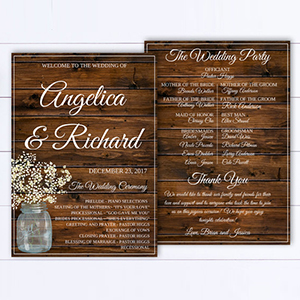 Wedding program with white text on a wooden background with a mason jar filled with white flowers on the side photo