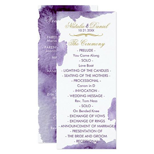 White wedding program with ultra violet watercolor detailing on the corners photo