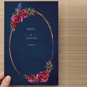 Navy wedding program with vintage oval frame with red roses on the top and bottom photo