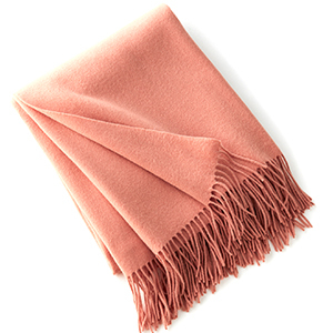 Salmon-colored cashmere throw with fringe at the end photo