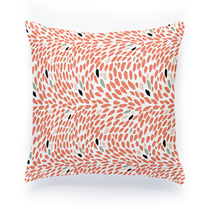 White pillow with coral leaves printed on it photo