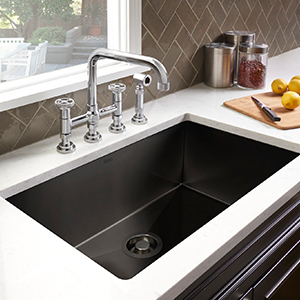 White counter with matte black sink dropped inside photo