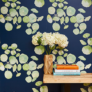 Blue wallpaper with light green botanical pattern photo