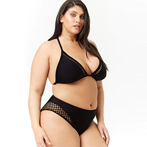 Black bikini bottoms with laser-cut detailing on the hip paired with matching triangle bikini top photo
