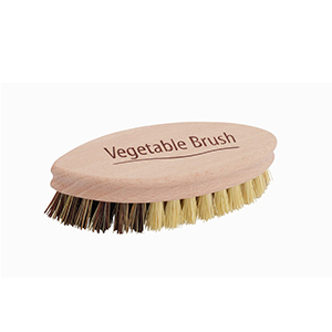 Tan vegetable brush with soft and stiff bristles photo