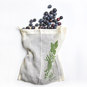 Cotton reusable bag with blueberries inside photo