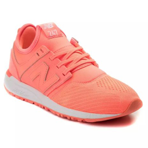 Neon pink New Balance shoe with a white sole. photo
