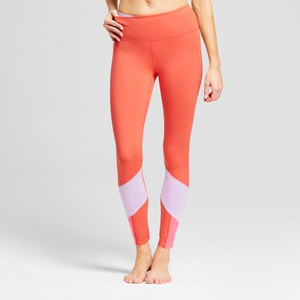Coral color block spandex leggings with light pink area on bottom legs. photo
