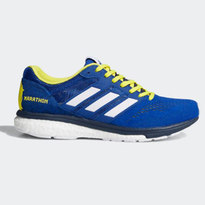 Cobalt blue Adidas women's running shoes with neon yellow laces and three white stripes on the side. photo