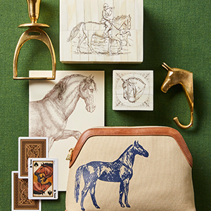 A variety of horse decor placed on a green background. photo