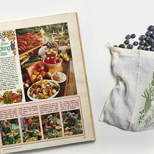Vintage BH&G magazine laying next to a bag of blueberries. photo