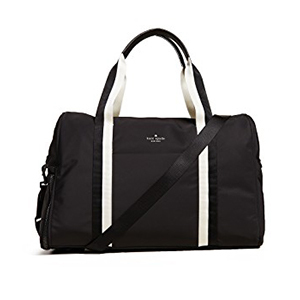 Black duffle bag with white handle and Kate Spade logo photo