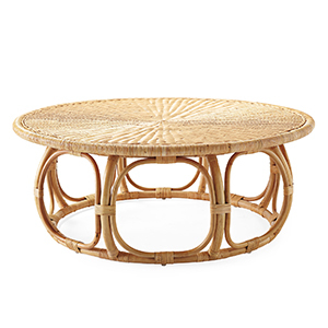 Round rattan coffee table with hand-bent base. photo