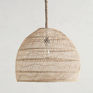 Hanging rattan ceiling light featuring a woven design. photo