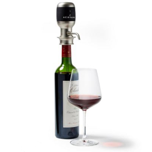 Bottle of wine with a wine aerator attached to the top for an easy pour. photo