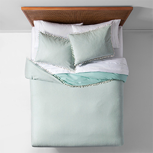 Mint duvet cover with tassel edging and matching pillow shams photo