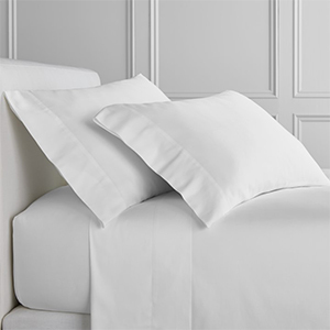 White Sleepsmart sheets with matching pillows photo