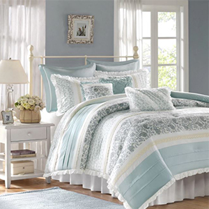Nine-piece comforter set that features shams, pillows, bed skirt, and comforter in periwinkle and paisley striped pattern photo