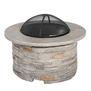 Round natural stone fire table photo