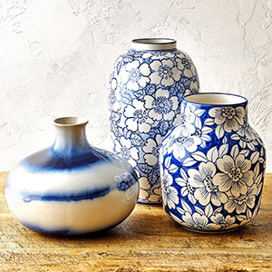 Cobalt vases with florals and stripes painted on them photo