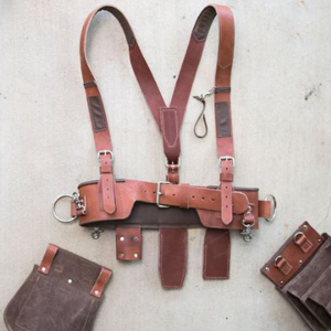 Brown tool belt with suspender straps and add-on pockets. photo