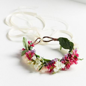 Boho-inspired flower crown with white ribbon tail. photo