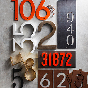 Round up of different house numbers on a gray background. photo