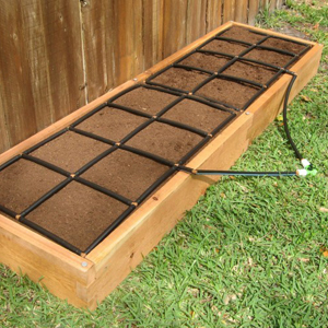 2x8 Wooden raised-garden bed with watering system. photo