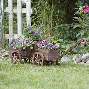 Two-tier wooden wagon garden planter filled with purple flowers photo