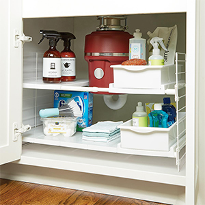 Under-the-sink organizer with expandable shelves and storage bins photo