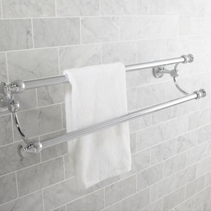 Double towel rack with white towel hanging on it photo