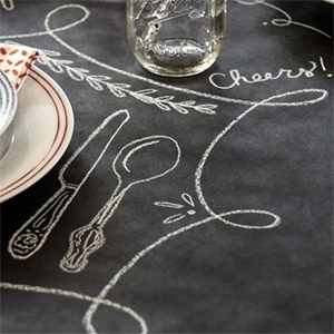 Chalkboard table runner with placemat and silverware drawn on it photo