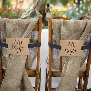 Brown and black chair banners with Mr. Right and Mrs. Always Right on them photo