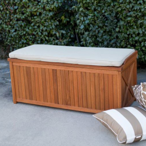 Wooden storage box with a white cushion on top. photo