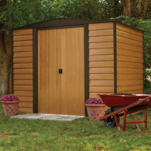 Wooden storage shed with double doors and black roof. photo