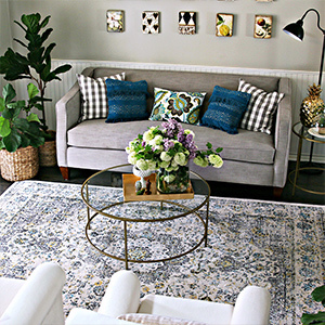 Coffee table, accent pillow, and decorative pillow by Better Homes & Gardens photo