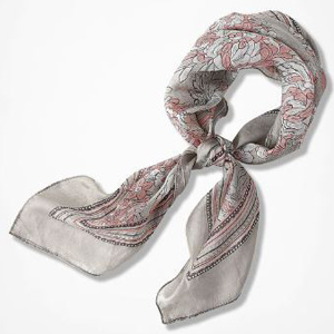 A gray scarf with a white and pink floral design. photo