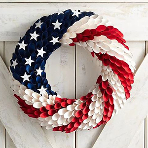 Wreath with curled poplar rosettes painted like the American flag with white stars on the top left photo