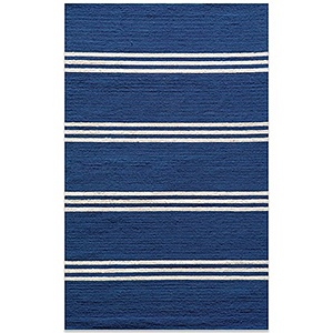 Cobalt blue outdoor and indoor area rug with white horizontal stripes on it photo